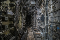 Computer wiring tunnel inside an abandoned coal power plant photo by Bryan Buckley