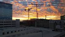 Construction tower cranes during sunrise in Austin TX