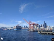 Container Ship MOL PARTNER starting up her engines as tugs pull her away from the terminal dock at the Port of Seattle
