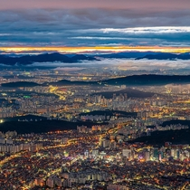 Continuing layers of mountain and cityscape in Seoul South Korea