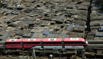 Contrasts Brand new Monorail begins service in Mumbai India passing over a shanty-town