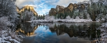 Cool and refreshing a snow storm blows through Yosemite leaving the valley dusted in a white powder El Capitan and Bridal Veil the guardians of the Valley reflect in the smooth still waters of the Merced River  by Darvin Atkeson