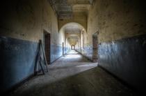 Corridor  a decaying hallway in Belgium  by Klare Sherwood