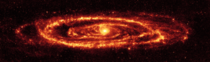 Cosmic dust of the Andromeda galaxy as revealed in infrared light by the Spitzer Space Telescope  NASAJPL
