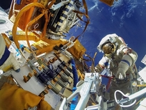 Cosmonauts work in outer space Posted by  Russian Space Agency