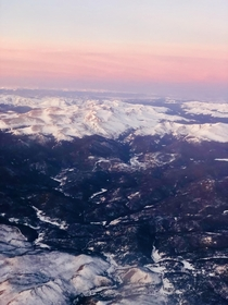 Cotton Candy Colorado Sunrise on mountains just outside Fort Collins Colorado seen on flight to Denver this morning