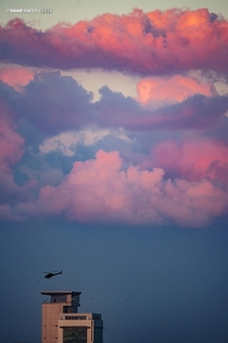 Cotton candy sky with a helicopter taking off