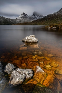 Cradle Mountain hiding behind some low clouds Tasmania Australia