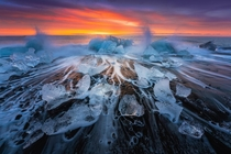 Crashing waves lots of ice and a crazy epic sunrise at the Diamond beach in Iceland OC