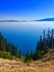 Crater Lake Oregon with a layer of smoke from a nearby Bushfire
