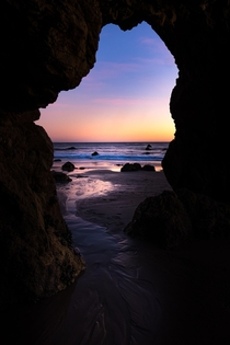 Crawled under my favorite rock formation to geta window view of a Malibu CA sunset