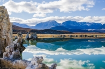 Crazy reflections of Mono Lakes tufas towers and the Sierra Nevada mountains in California