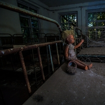 Creepy doll in abandoned kindergarten Kopachi village in Chernobyl exclusion zone