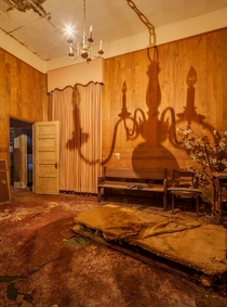 Creepy orange glow in an abandoned funeral home by Ghostcri