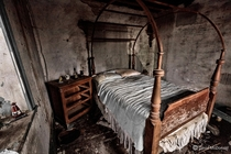 Cross post suggested A shot of a young girls bedroom in an abandoned stone house with the bed still made