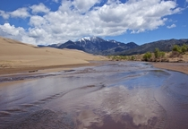 Crossing Medano Creek in Great Sand Dunes National Park CO