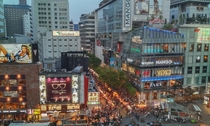 Crowded streets of Myeong-dong Ward a major shopping district in downtown Seoul South Korea