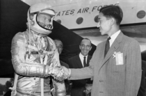 Crown Prince Akihito of Japan shakes hands with astronaut L Gordon Cooper at Langley Field Virginia September