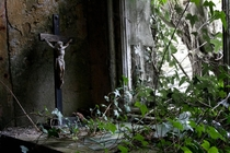 Crucifix in window of abandoned home Ireland