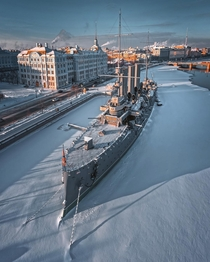 Cruiser Aurora a th century warship that served during the Russo-Japanese War docked on the Bolshaya Nevka river flowing through Saint Petersburg Russia