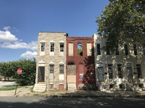 Crumbling abandoned rowhouses next to occupied ones in Baltimore Maryland