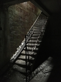 Crumbling staircase in the basement of a derelict insane asylum in Maryland