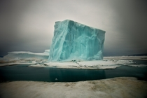 Cube-shaped iceberg in the waters off northern Greenland photo by Sebastian Copeland