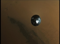 Curiositys heatshield falling to the martian surface seconds after detaching  NASA picture