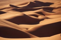 Curves - smooth sand dunes of the Sahara desert in Libya  photo by Ivan losar