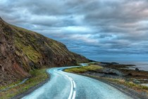 Curving road on in the northwest fjordlands area of Iceland