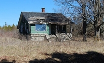 Cute green house on old US- in St Ignace Inside was still intact and filled with furniture and belongings Abandoned
