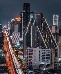 Cyberpunk Bangkok Thailand Thats a condominium in the front named Ideo Q Chula and in the back in all black is the Ashton known for building matte black high rise condos that look epic