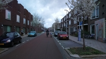 Cycling street in Utrecht the Netherlands cars are allowed but cyclists have priority