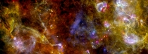 Cygnus-X star-formation region by Herschelnetworks of dust and gas lead to star formation The image combines far-infrared data acquired at  micron blue channel  micron green channel and  micron red channel