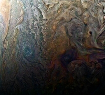 Dark spot on Jupiter seems to reveal a Jovian galaxy of swirling storms