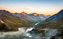 Daybreak in the Swiss Alps - view of the valley and glacial moraines from Cabane de Moiry Valais Switzerland