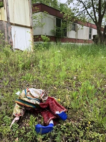 decapitated clown doll from this abandoned trailer in the boonies inside looked like it could have been nice in a past life but is now completely trashed and rotting reason for abandonment unknown