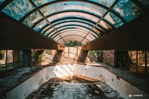 Decaying indoor pool of an abandoned mountain Resort