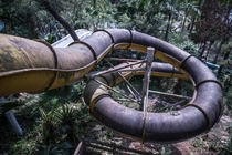 Decaying slide at an old theme park Thailand