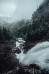 Deep in the Mission Mountains of Montana watching the fog roll in from the top of the waterfall