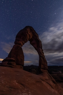 Delicate Arch lit only by the moon Arches National Park Moab UT