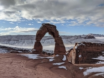 Delicate Arch with snow at Arches National Park UT