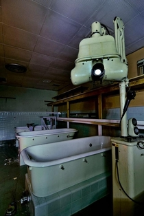 Dental X ray machine and old hydro-therapy tubs in a basement at Agnews Hospital Oddly enough there is also a bicycle powered band saw in the background OC x