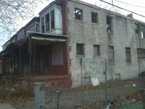 Depressing graffiti on derelict homes in Camden NJ