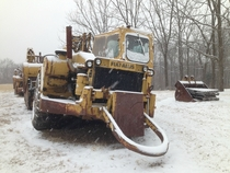 Derelict construction equipment during a snowstorm in Saint Albans MO