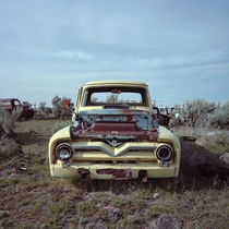 Derelict  ford F pickup seen in a high desert junkyard somewhere in idaho By eyetwist