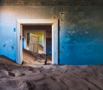 Desert reclaims a home in the abandoned diamond mining town of kolmanskop Namibia