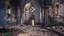 Desolate - abandoned church of former college in south France photo by Andy Schwetz