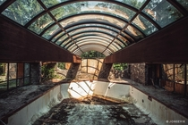 Deteriorating Indoor pool at a forgotten mountain Resort