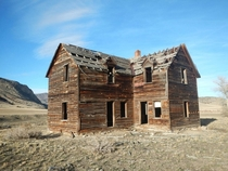 Deteriorating ranch house near Sappington MT